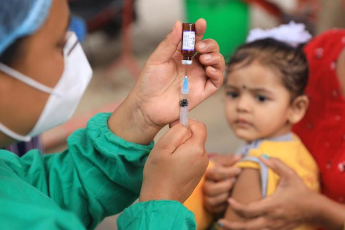 A child waits to be vaccinated in Nepal in July 2020.
