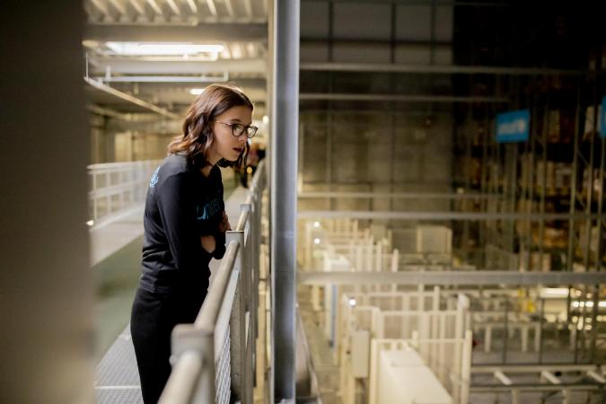 UNICEF Goodwill Ambassador Millie Bobby Brown views the automated High Bay storage area in the largest humanitarian warehouse.