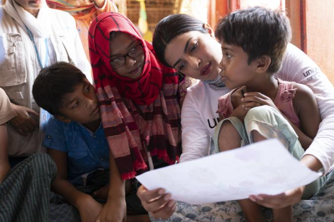 "Priyanka Chopra visits Rohingya refugee children at a Child Friendly Space (CFS). Child Friendly Spaces, one of UNICEF's Child Protection interventions, provide children with protected environments in which they participate in organised activities to play, socialise, learn and express themselves in Balukhali - part of the so-called ""Megacamp"" which comprises the world's largest refugee site - in Cox's Bazar district, Bangladesh on 22 May 2018."