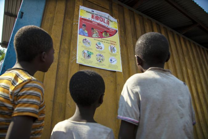 Children look at an Ebola poster, DRC