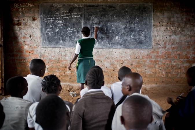 South Sudan. A girl completes school work in a classroom in Yambio, South Sudan.