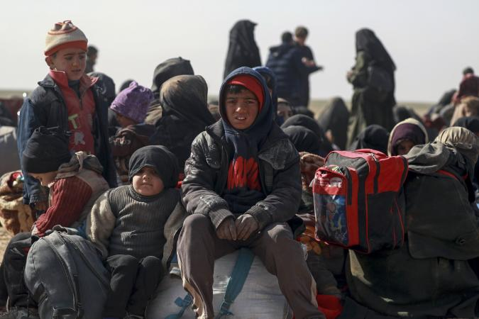 Syria. Children and families are huddled together after being forced to flee their homes.