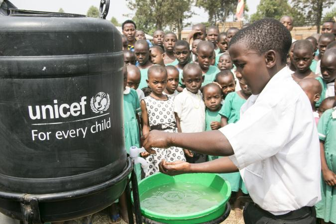 Uganda. A child demonstrates to other pupils how to wash hands.