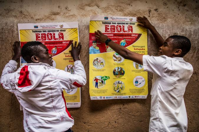 Democratic Republic of the Congo. Students put up a poster detailing Ebola sensitization at a school in Butembo.