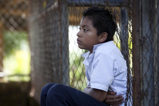 A boy at school in El Salvador