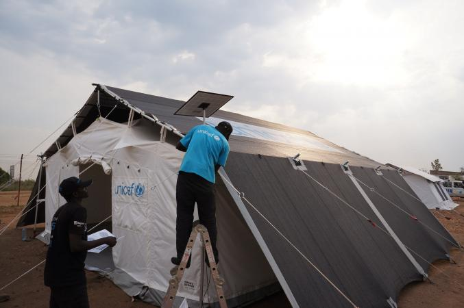 Uganda. A prototype of a High Performance Tent is assembled for testing in hot and dry weather conditions.