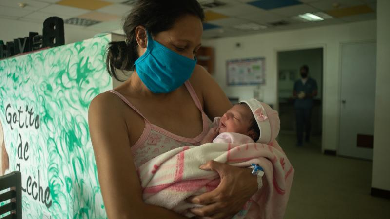 A woman keeps in her arms her newborn daughter during a breastfeeding workshop in a health center located in Caracas, Venezuela.
