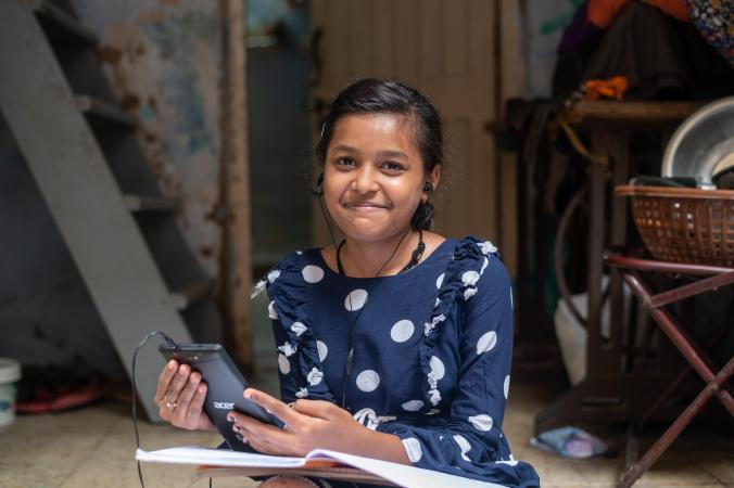 Girl in India learning from home using a tablet.