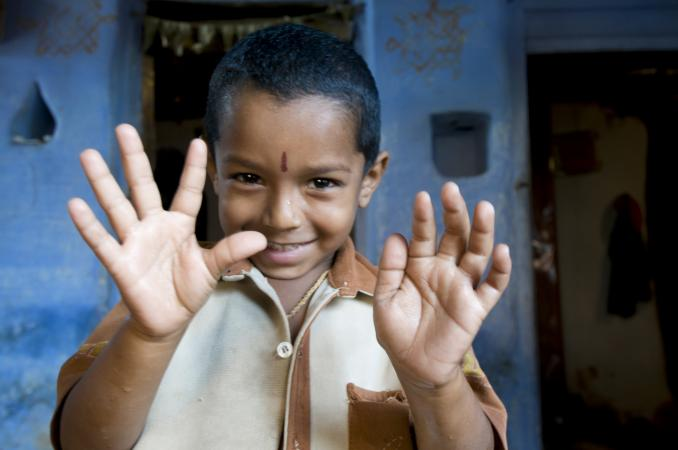 A boy shows his hands, India