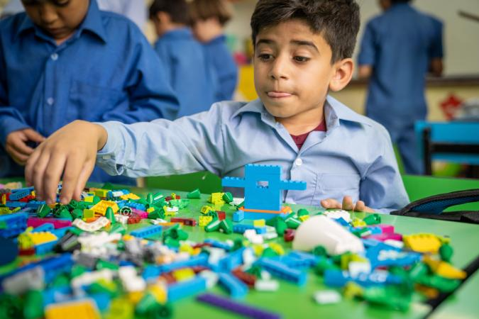 Yousef plays with LEGO at his school in Jordan