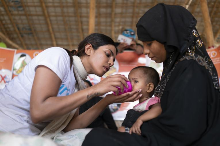 UNICEF Goodwill Ambassador Priyanka Chopra helps feed a Rohingya refugee baby at a UNICEF-supported therapeutic feeding center for malnourished children.in Jamtoli camp, Cox's Bazar district, Bangladesh on 23 May 2018.