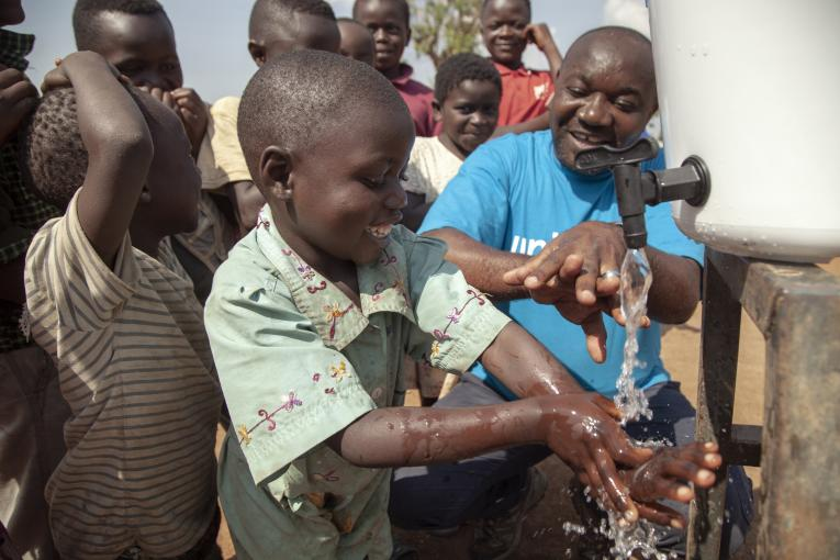 On 13 August 2018, Jean Marie Bofio, UNICEF's WASH Officer, demonstrates to children how to correctly wash their hands in order to prevent the spread of Ebola near Mangina, North Kivu, the Democratic Republic of the Congo (DRC).