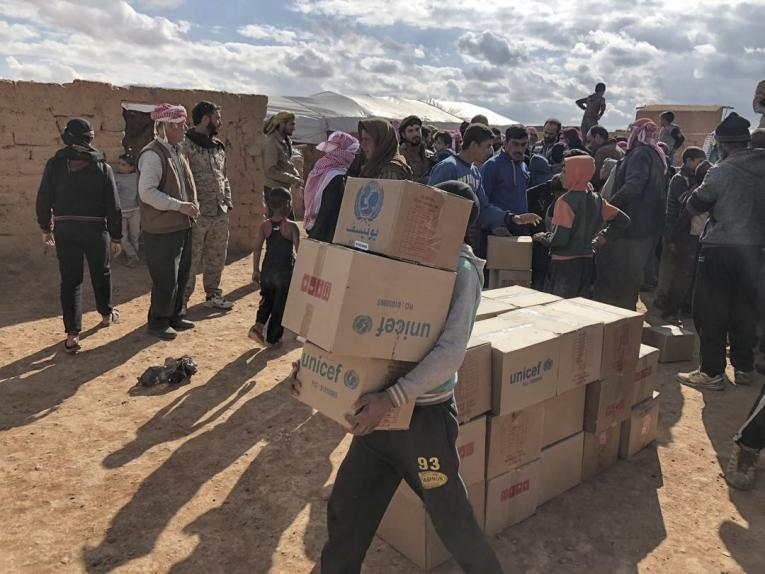 UNICEF humanitarian supplies are distributed to children and families in Rukban camp in southeast Syria near the Jordanian border. This is the first convoy to the camp from within Syria, where nearly 50,000 people live, the majority of whom are women and children