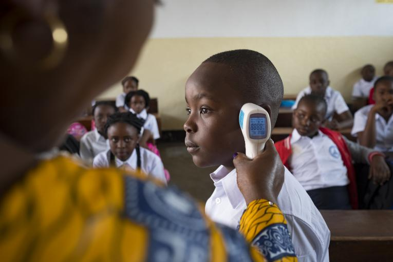 On 2 September 2019, Jacqueline Maga Znigire, deputy director of The Volcano School of Goma, instructs students on how to protect themselves from Ebola. Here she's using a digital thermometer to check the temperature of a student. A high temperature is an early sign you might have Ebola.