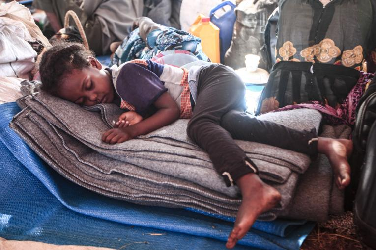 An Ethiopian refugee child who fled fighting in Tigray province, sleeps in a hut at the Um Raquba camp in Sudan's eastern Gedaref province, on 16 November 16 2020