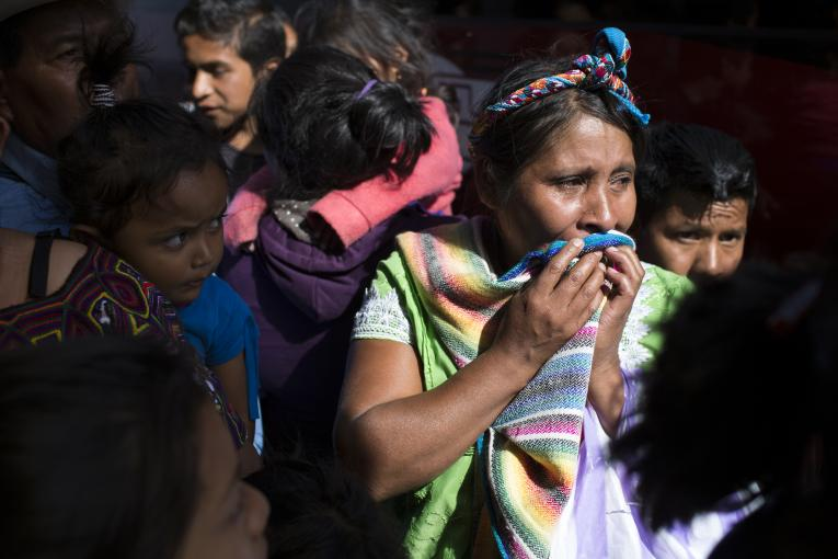 "A mother cries in anticipation of meeting her son, who had been deported from Mexico, at the governmental reception shelter ""Nuestras Raices"" (""Our Roots"", in English) in Quetzaltenango, Guatemala on May 3, 2018. All minors deported from Mexico are sent to this center by bus."