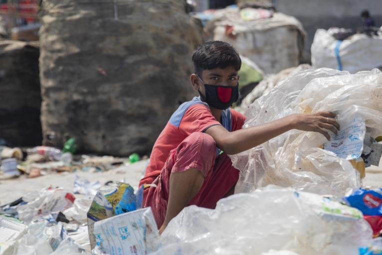 12-year-old Miajul sorts through hazardous plastic waste in Dhaka, Bangladesh, to support his family during the COVID-19 pandemic.
