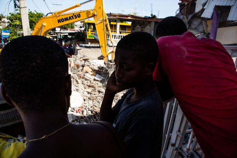 Children oversee an excavation in the city of Les Cayes, Haiti