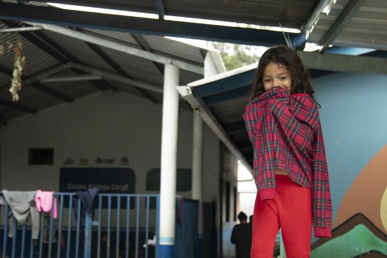 A girl tries to cover herself from the cold in the shelter set up at the Professor Toribio Bustillo school, in the Las Brisas de Tegucigalpa neighborhood,