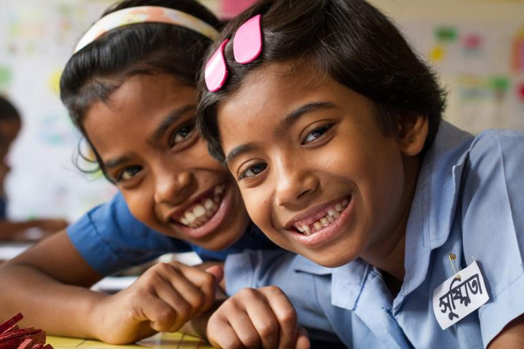 Shushmita Rani and her friend Binky at primary school in Dhaka, Bangladesh.