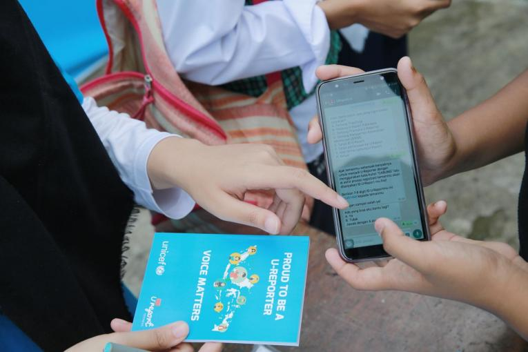 A young person In Indonesia demonstrates how to be U-Reporter and become agent of change using WhatsApp application