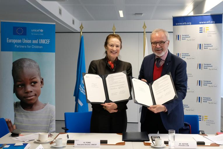 UNICEF Executive Director Henrietta Fore and European Investment Bank (EIB) Group President Werner Hoyer hold the newly signed Memorandum of Understanding (MoU) between UNICEF and the EIB