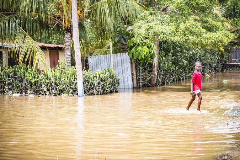 Outside the town of Ouanaminthe, Haiti, a child wades through the flood waters where several small villages suffered significant damages caused by Hurricane Irma. 8 September 2017.