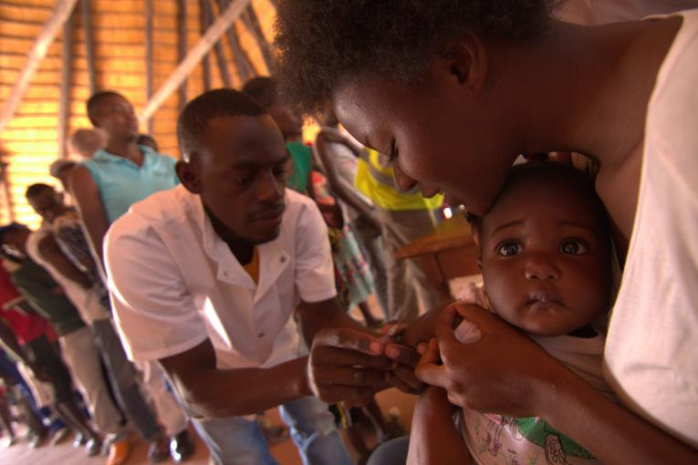 A baby is vaccinated against yellow fever in Angola