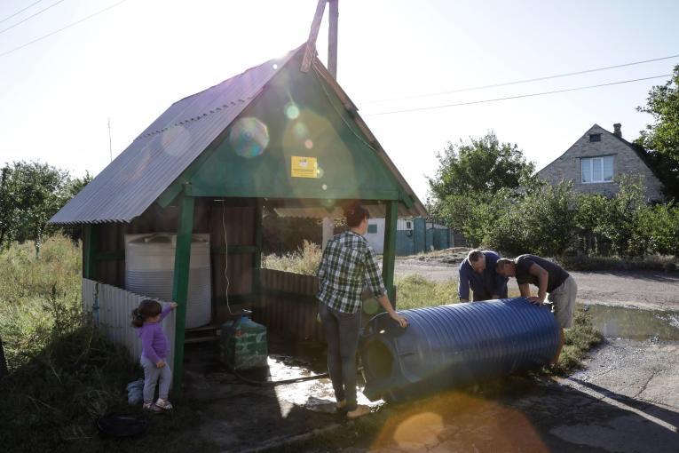 Ukraine. Residents gather at a water point in Bakhmutka, Donetsk region.