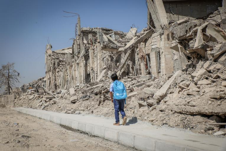A child walks in West Mosul, Iraq.