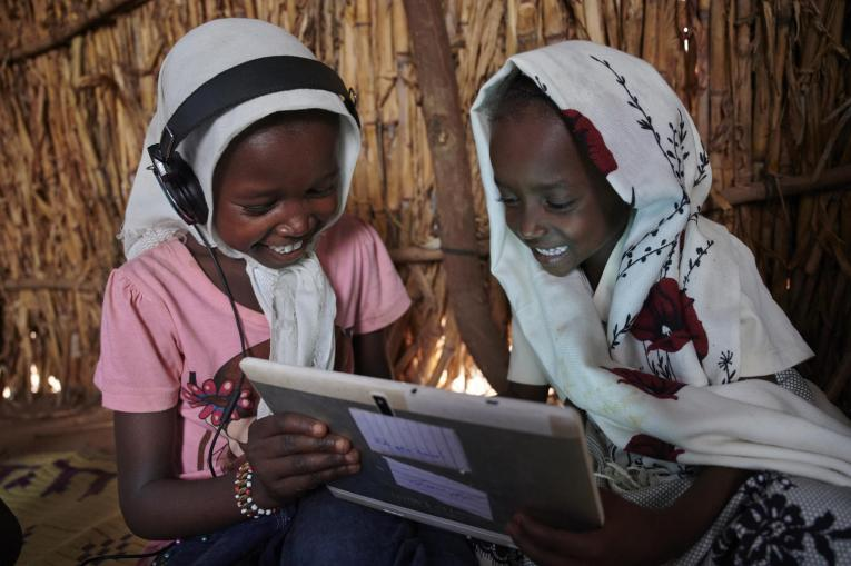 Children use their tablet to learn in a village on the outskirts of Kassala in Eastern Sudan.