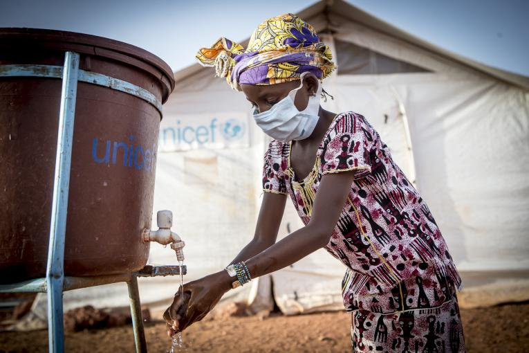 Hamsatou, 13, washes her hands at the Socoura displacement camp in Mopti, Mali.