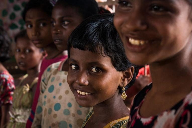 Children smile in a refugee camp in Bangladesh