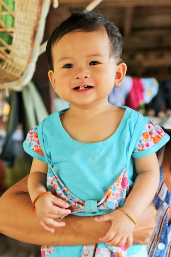 A baby smiles, Lao PDR