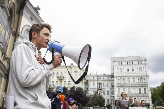 A boy shouts into a megaphone, Ukraine