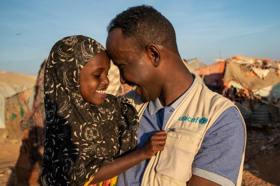 UNICEF Child Protection Officer speaks with a girl who lives in an IDP camp in Garowe.