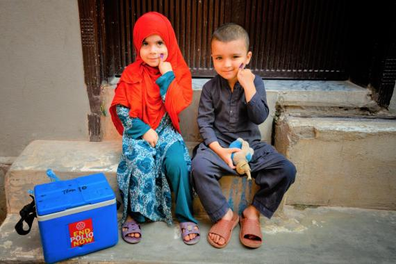 Children in Pakistan receive vaccines.