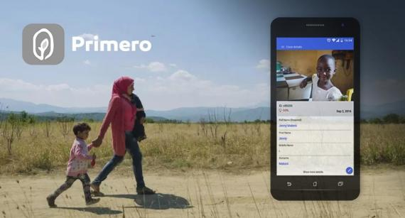 Image of 'Primero' phone application with a photograph of a woman walking along a dusty road holding a small child in her arms and an older child walks beside her holding her hand