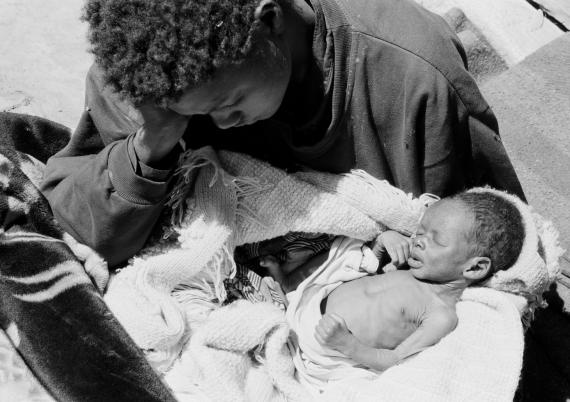 In 2002 in Zambia, a woman, 21, holds her malnourished three-week-old baby, in the village of Limboa in Kalomo District in Southern Province.