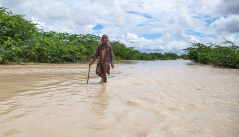 boy-walking-in-flood-water