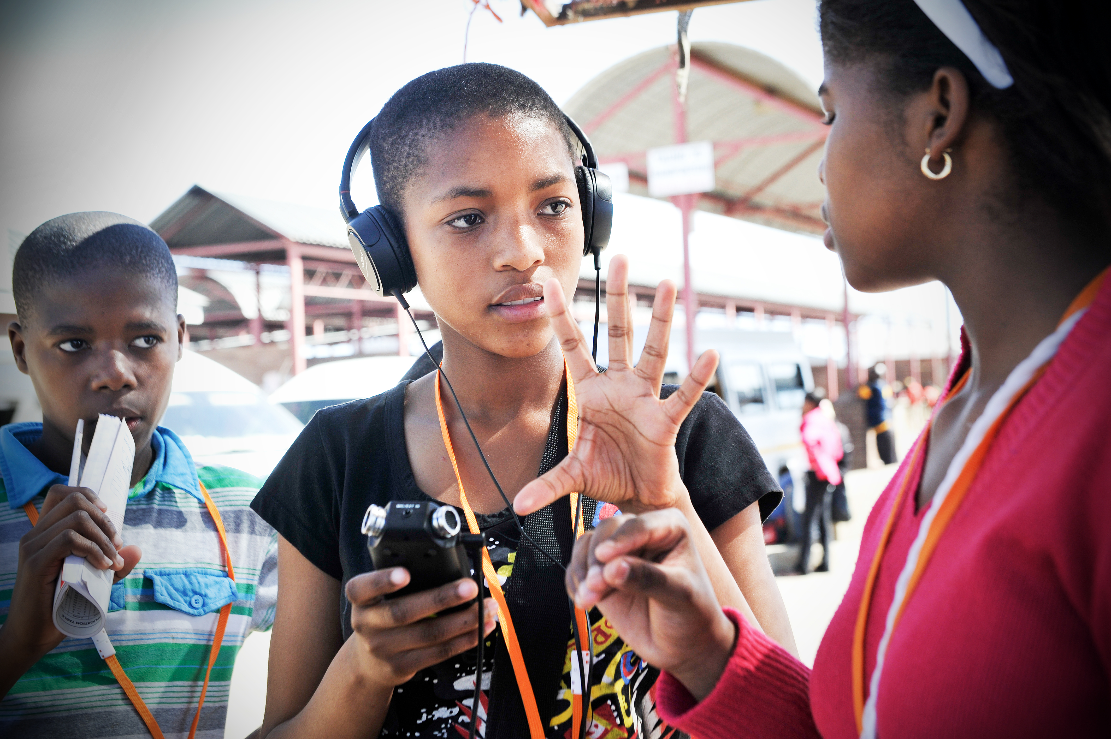 Young girl interviewing another for radio programme