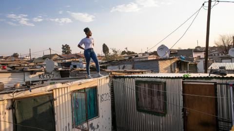 girl-look-out-over-informal-settlement