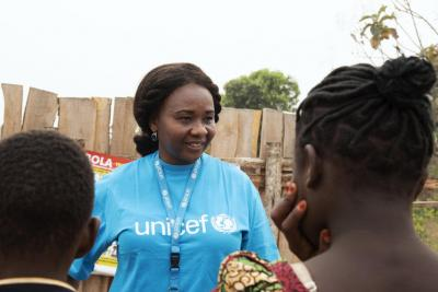 UNICEF Child protection officer Anna Hadjixiros is giving an orientation to children who have turned up for the release
