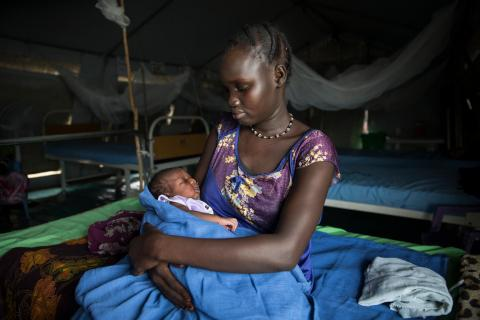 Mother and her baby (no name yet) at the UNICEF supported IMC Maternity ward in the POC in Malakal.