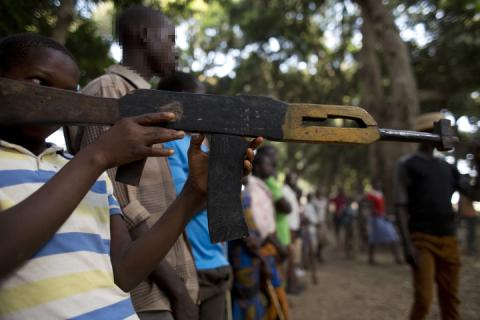 a child is pointing with a home made gun