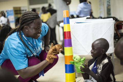 An Education officer is playing with a child