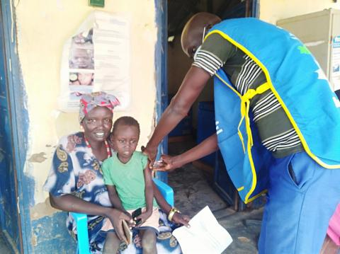 A child being immunized