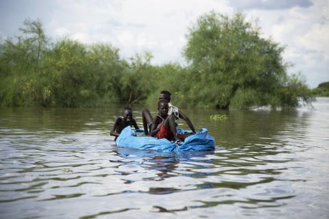 children on a makeshift raft