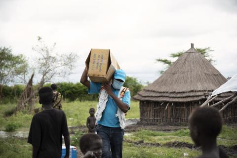 A UNICEF worker carrying supplies