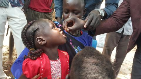 A child receiving deworming tablet
